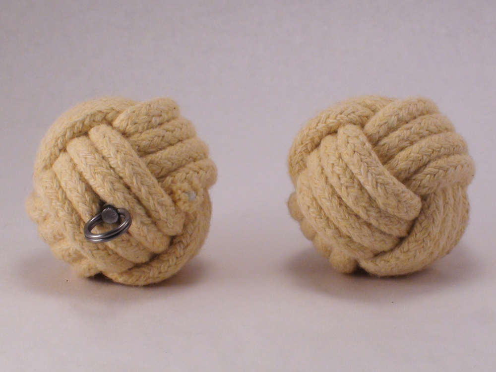 a staple beloved style of fire poi the monkey fist are widely used due to their longer burn time and comfortable weight burning monkey fist fire - Monkey Fist